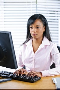 2120753-serious-black-businesswoman-at-desk